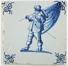 Antique Dutch Delft tile depicting a soldier as a Standard-Bearer