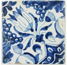 Antique Delft ornament tile in blue with a beautiful Tulip, early 17th century
