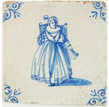 Antique Dutch Delft tile with a wealthy woman on a chair, 17th century
