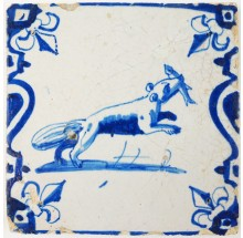 Antique Delft tile with an otter holding a fish between its jaws, 17th century