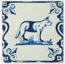 Antique Delft baluster tile with a fierce looking dog in blue, 17th century