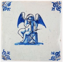 Antique Delft tile in blue with Cupid holding a trumpet and a drum set, 17th century