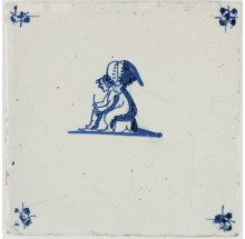 Antique Delft tile with Cupid sitting on a bench, 17th century