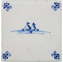 Antique Dutch Delft tile in blue depicting several types of fruit, 17th century