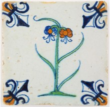 Antique Dutch Delft tile with a double polychrome flower, 17th century Gouda