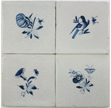 Antique Dutch Delft wall tiles with small flowers in blue