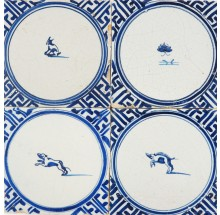 Antique Delft wall tiles in blue with small animals in a circle and Wanli inspired corner decoration, 17th century Harlingen