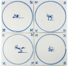 Antique Dutch Delft wall tiles with animals in blue circle 'springers', 18th - 19th century