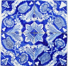 Antique Dutch Delft ornamental wall tiles with flower design