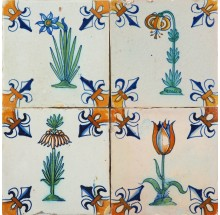 Antique Dutch Delft wall tiles with polychrome flowers with a fleur-de-lis corner, 17th century