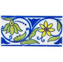 Antique polychrome Delft border tile with a tulip and a chalice, 20th century