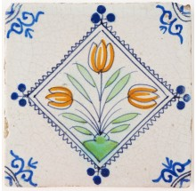 Antique Delft tile with polychrome tulips in a diamond square, 17th century