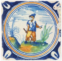 Antique Delft polychrome circle-cord tile with a figure swinging a club, 17th century