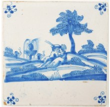 Antique Delft tile depicting a romantic scene between a couple in a Dutch landscape, 17th century
