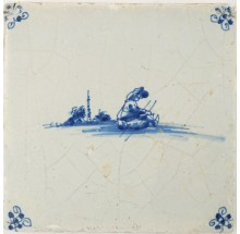 Antique Delft tile in blue with a man on a sledge, 17th century