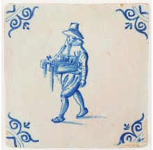 Antique Delft tile in blue with a peddler, 17th century