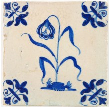 Antique Delft tile in blue with a flower and lily corner motifs, 17th century