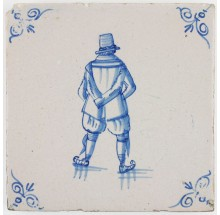 Antique Dutch Delft tile in blue with a man skating on ice, 17th century