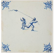 Antique Delft tile in blue with two children flying a kite, 17th century