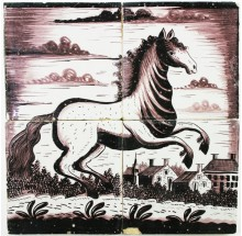 Antique Delft tile mural with a prancing horse in manganese, 19th century