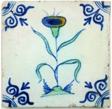 Polychrome Delft tile with a Dandelion type of flower